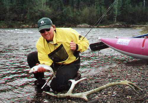 Brian makes a quick cast and catch Below Gulkana River Canyon section - ALASKA RAFT CONNECTION